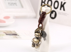 Hand and foot movable cartoon cowhide keychain retro woven leather car keychain small gift