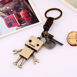 Hand-woven cowhide key chain movable alloy robot creative leather key chain wholesale backpack pendant