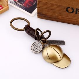 Retro cowhide keychain hand-woven bronze baseball cap leather keychain creative gift